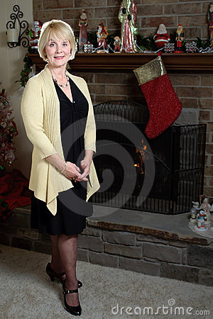 Woman smiling fireplace Christmas