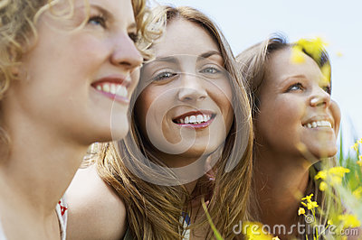 Woman Smiling While Friends Looking Away