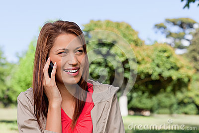 Woman smiling while looking towards her left side