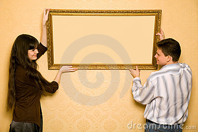 Woman and smiling man hang up on wall picture