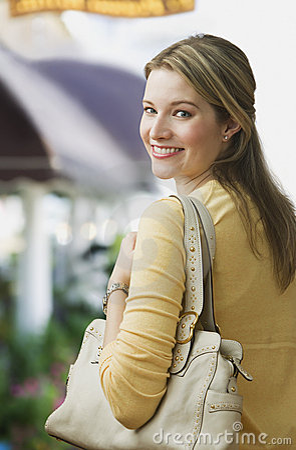 Woman Smiling over Shoulder