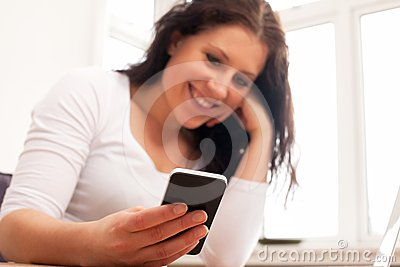 Woman Smiling While Reading Text Message
