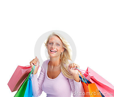 Woman smiling with shopping bags on white