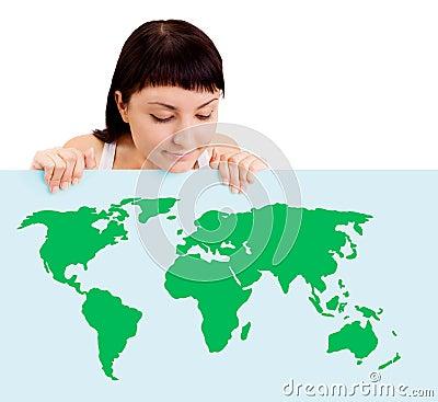Woman smiling showing earth globe on billboard