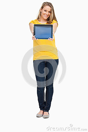 Woman smiling while showing a touch pad screen