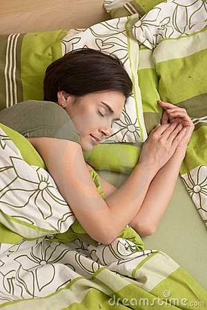 Woman smiling in sleep