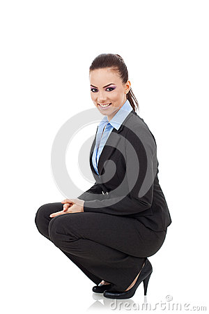 Woman smiling in squat position