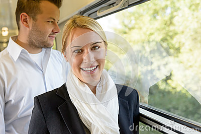 Woman smiling in train man selective focus