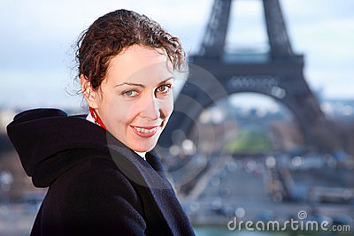 Woman smiling, view of Eiffel Tower at winter