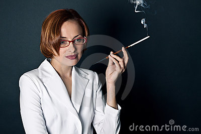 Woman smokes a cigaret