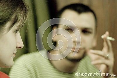 Woman and smoking man