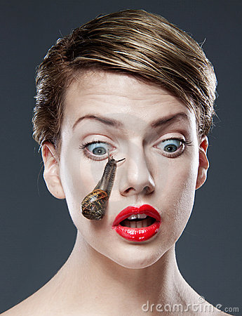 Woman with snail on face