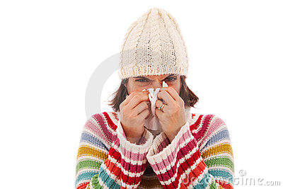 Woman sneezing to a tissue