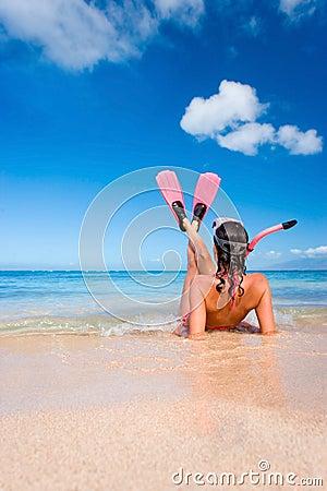 woman snorkel flippers on beach