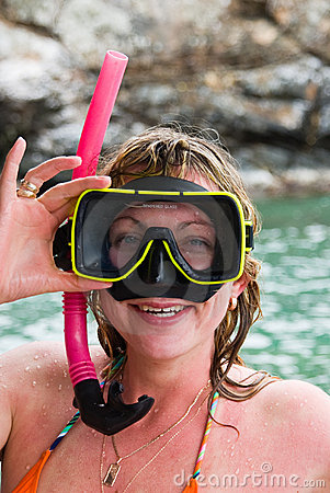 Woman with snorkeling equipment