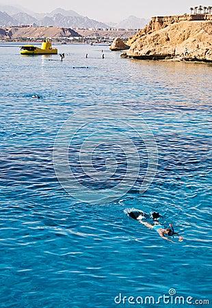 Woman Snorkeling in open blue