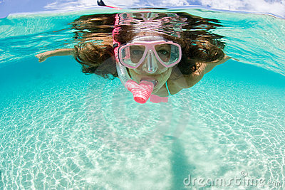 Woman snorkeling tropical