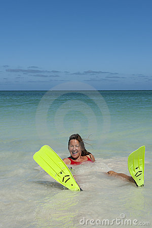 Woman snorkelling at tropical beach