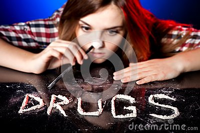 Woman snorting cocaine or amphetamines, drug addiction