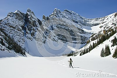 Woman snowshoeing in the Canadian rockies
