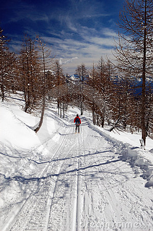 Woman snowshoeing descending