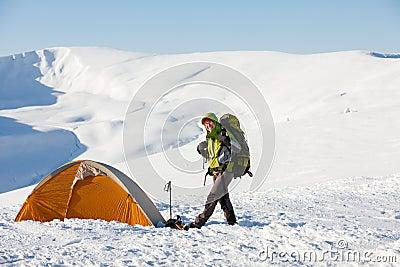 Woman snowshoeing in winter Carpathian mountains