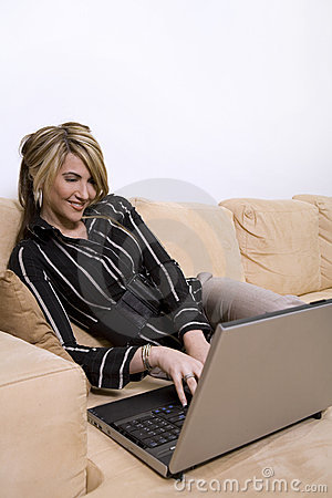 Woman on sofa using computer
