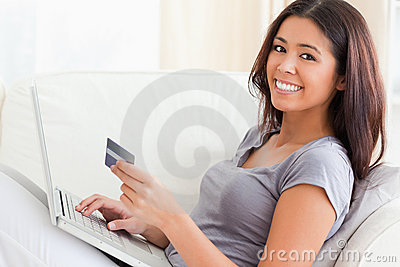 Woman on sofa woriking with notebook