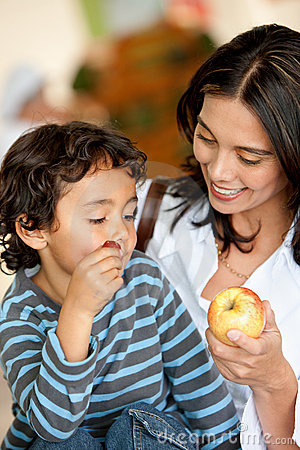 Woman and son eating fruits