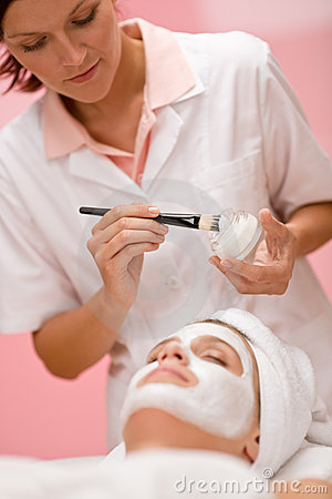 Woman at spa getting facial mask