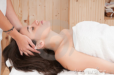 Woman in spa getting a massage on her face