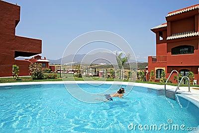 Woman in Spain, swimming in pool