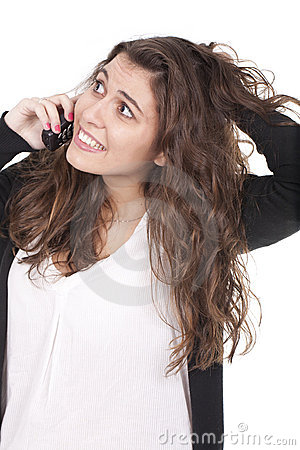 Woman spealking on the phone and holding her hair