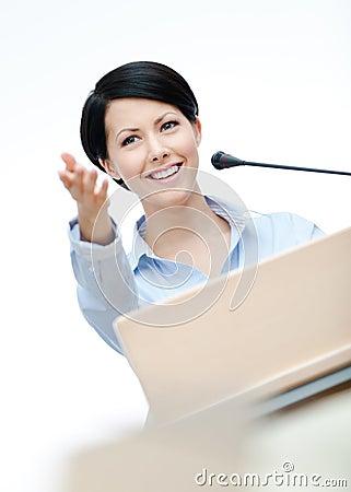 Woman speech maker at the board