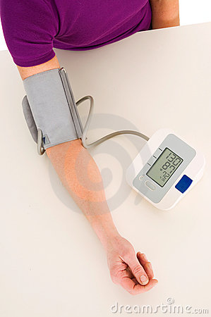 Woman with sphygmomanometer