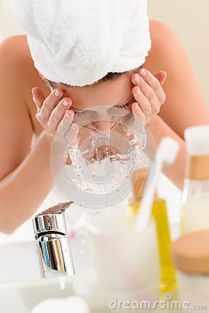 Free Woman Splashing Water Face In Bathroom Royalty Free Stock Photo - 26352925