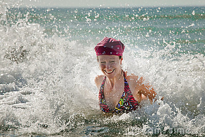 Woman in splashing wave