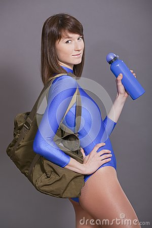 Woman with sport bag and bottle