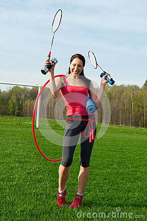 Woman with sport equipments
