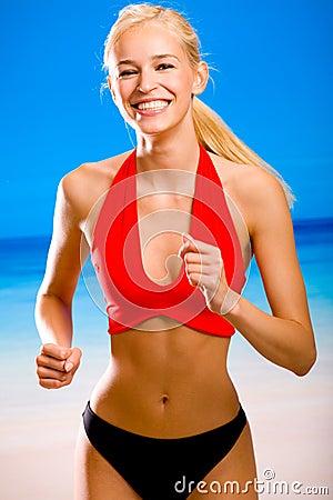 Woman in sport-wear on beach