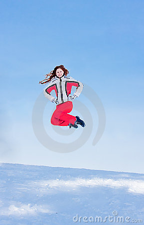 Woman in a sporting suit jumps  in-field