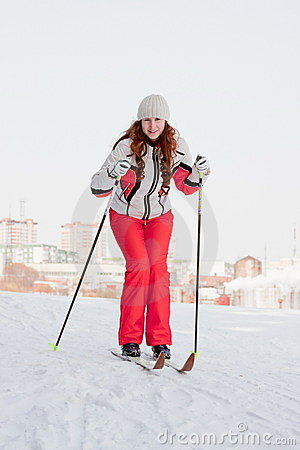 Woman in a sporting suit on skis