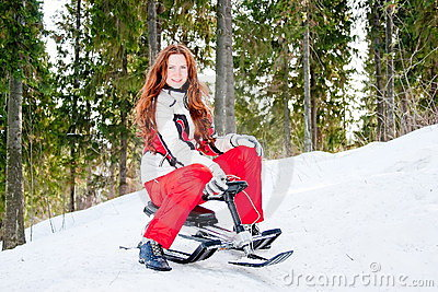 Woman in a sporting suit on sledges  in-field