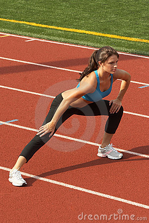 Woman in Sports Bra Doing Leg Lunge
