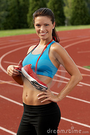 Woman In Sports Bra With Running Shoes Around Her Neck Stock ...