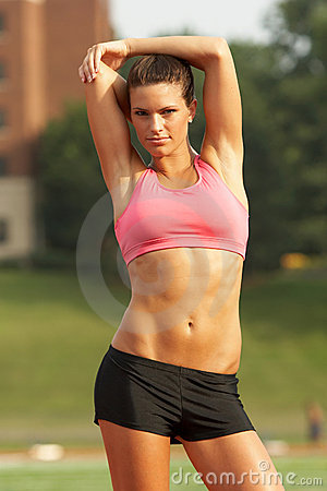 Woman in Sports Bra Stretching