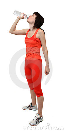 Woman in sports outfit drinking water