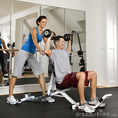 Free Woman Spotting Man At Gym Stock Image - 4553741