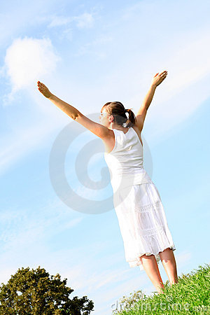 Woman spreading arms to sky
