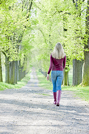 Woman in spring alley
